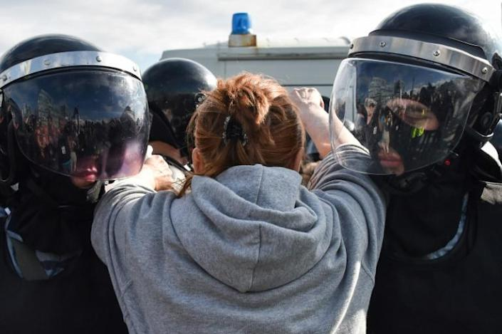Riot police appeared to outnumber small groups of protesters who were walking along stretches of the leafy Boulevard Ring (AFP Photo/Vasily MAXIMOV )