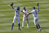 New York Mets center fielder Billy Hamilton (21), left fielder Michael Conforto (30) and left fielder Brandon Nimmo (9) celebrate after they defeated the Miami Marlins in a baseball game at Citi Field, Sunday, Aug. 9, 2020, in New York. (AP Photo/Kathy Willens)
