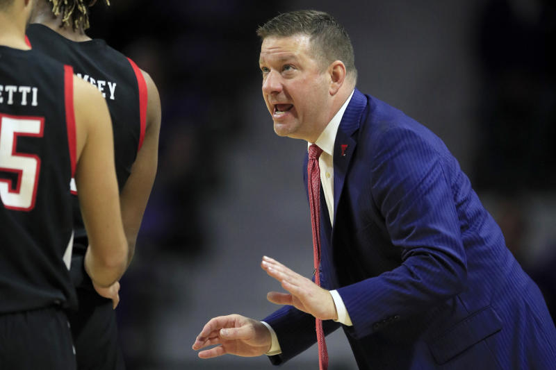 Texas Tech head coach Chris Beard talks with his players during the second half of an NCAA college basketball game against Kansas State in Manhattan, Kan., Tuesday, Jan. 14, 2020. Texas Tech defeated Kansas State 77-63. (AP Photo/Orlin Wagner)