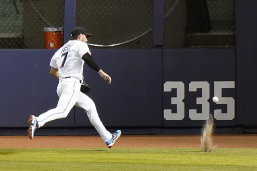 Miami Marlins right fielder Matt Joyce chases down a ball hit by Philadelphia Phillies' Didi Gregorius for a double during the fourth inning of a baseball game, Thursday, Sept. 10, 2020, in Miami. (AP Photo/Wilfredo Lee)