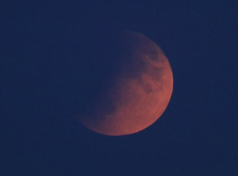A partial lunar eclipse, visible above London from Primrose Hill (PA)