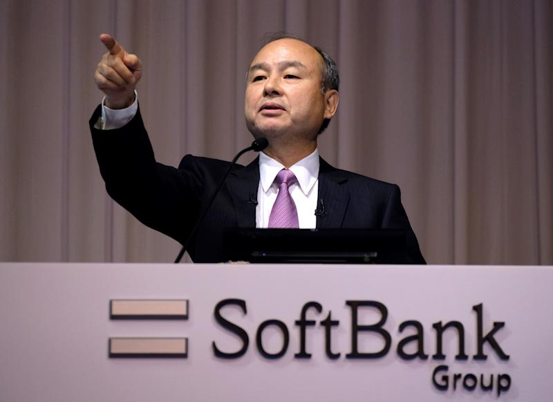 Japan's SoftBank Group CEO Masayoshi Son appoints a questioner during a press conference on the company's financial results in Tokyo on November 6, 2019. - Japanese giant SoftBank Group said Wednesday it suffered an operating loss of $6.4 billion in the second quarter, the worst in its history, taking a hit from investments in start-ups including WeWork and Uber. (Photo by Kazuhiro NOGI / AFP) (Photo by KAZUHIRO NOGI/AFP via Getty Images)