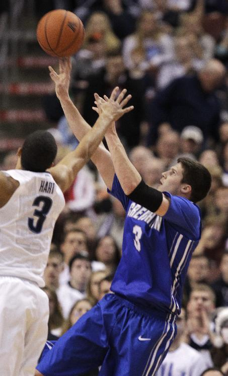 Creighton's Doug McDermott (3) takes a shot past Villanova's Josh Hart (3) in the first half of an NCAA college basketball game, Monday, Jan. 20, 2014, in Philadelphia. (AP Photo/Laurence Kesterson)