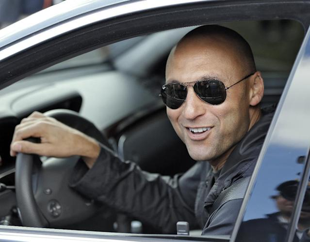 New York Yankees shortstop Derek Jeter smiles as he leaves after practicing at the Yankees' minor league facility Thursday, Feb. 13, 2014, in Tampa, Fla. Jeter announced that he will be retiring after the 2014 season. (AP Photo/Chris O'Meara)