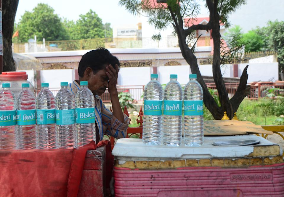 An indian vendor takes a nap in his drinking water bottle cart during a hot day in the outskirts of Allahabad on June 5, 2019 . Temperatures passed 50 degrees Celsius (122 Fahrenheit) in northern India as an unrelenting heatwave triggered warnings of water shortages and heatstroke.(Photo by Ritesh Shukla/NurPhoto via Getty Images)