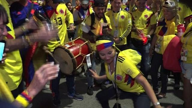 Colombia fans celebrate their side's 3-0 win in Kazan, Russia, while Poland fans lament being eliminated from the World Cup. 16.