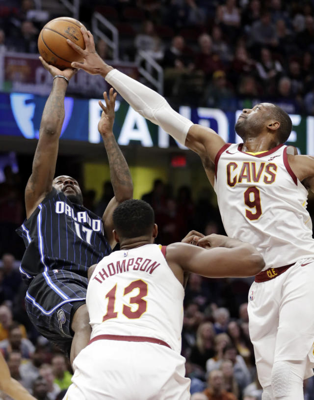 "<a class=""link rapid-noclick-resp"" href=""/nba/teams/cle/"" data-ylk=""slk:Cleveland Cavaliers"">Cleveland Cavaliers</a>' <a class=""link rapid-noclick-resp"" href=""/nba/players/3708/"" data-ylk=""slk:Dwyane Wade"">Dwyane Wade</a> (9) blocks a shot by Orlando Magic's Jonathon Simmons (17) as <a class=""link rapid-noclick-resp"" href=""/nba/players/4884/"" data-ylk=""slk:Tristan Thompson"">Tristan Thompson</a> (13) defends during the second half of an NBA basketball game Thursday, Jan. 18, 2018, in Cleveland. The Cavaliers won 104-103. (AP Photo/Tony Dejak)"
