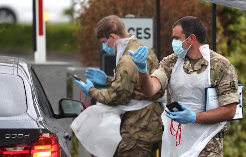 Soldiers provide instructions to people arriving at a Covid-19 testing centre in a Park and Ride facility in Salisbury, Wiltshire, as the UK continues in lockdown to help curb the spread of the coronavirus. (Photo by Andrew Matthews/PA Images via Getty Images)