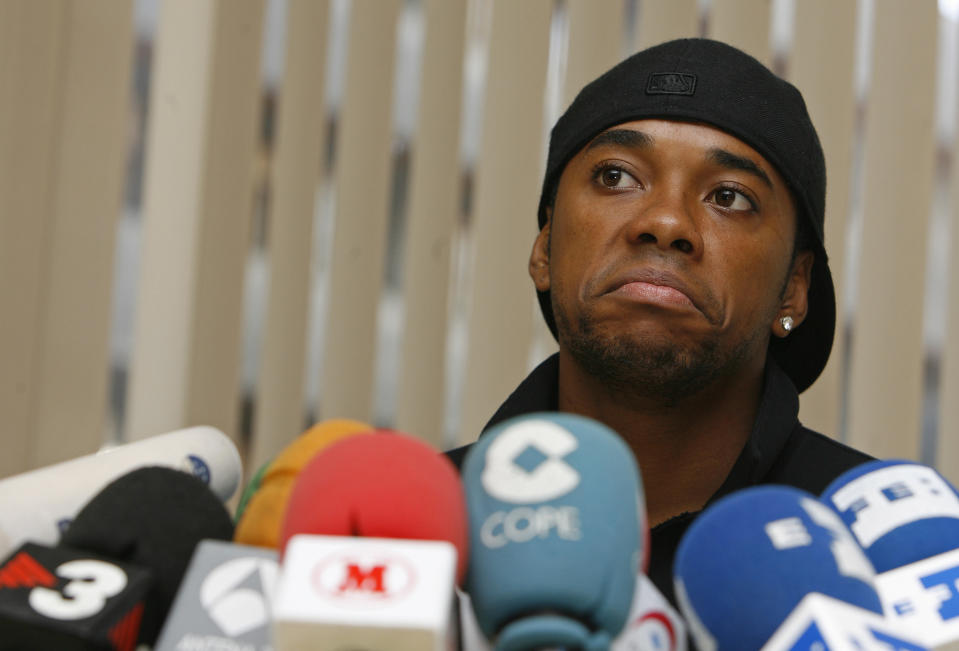 "Real Madrid's Brazilian soccer player Robinho looks on during a news conference in a hotel as he made a desperate late bid to persuade Real Madrid to allow him to move to Chelsea, with the summer transfer window due to close in just 24 hours, in Madrid August 31, 2008.  Robinho said ""I want to leave Real Madrid and play for Chelsea, I am only thinking of Chelsea and want to play there"".  REUTERS/Paul Hanna  (SPAIN)"
