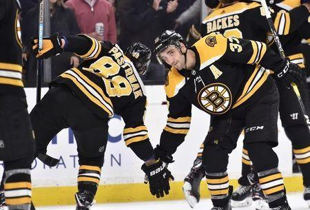 "Boston Bruins center <a class=""link rapid-noclick-resp"" href=""/nhl/players/3383/"" data-ylk=""slk:Patrice Bergeron"">Patrice Bergeron</a> (37) celebrates with right wing <a class=""link rapid-noclick-resp"" href=""/nhl/players/6391/"" data-ylk=""slk:David Pastrnak"">David Pastrnak</a> (88) after defeating the <a class=""link rapid-noclick-resp"" href=""/nhl/teams/ott"" data-ylk=""slk:Ottawa Senators"">Ottawa Senators</a> at TD Garden. Mandatory Credit: Bob DeChiara-USA TODAY Sports"