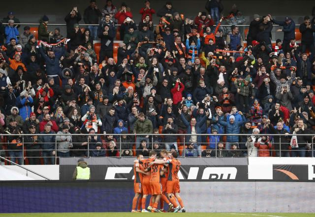 Soccer Football - Russian Football Championship - Ural vs Spartak Moscow - Ekaterinburg Arena, Yekaterinburg, Russia - April 15, 2018 Ural's players celebrate their first goal scored by Eric Bicfalvi. REUTERS/Sergei Karpukhin