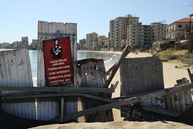 Pictured is a metal fence blocking entry to Varosha.