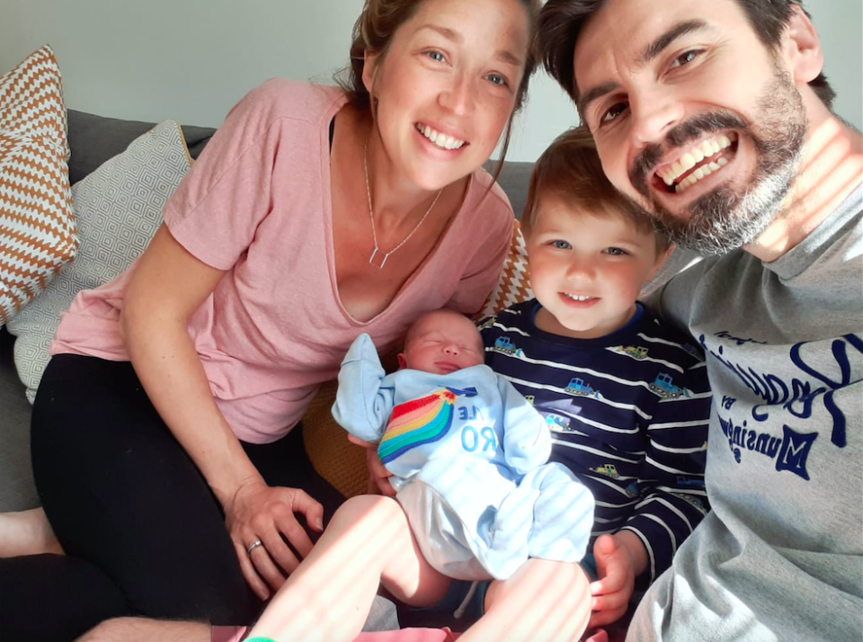 Hannah and Andy Howells with their son Theo and baby Wilf, who was delivered in a supermarket car park after paramedics mistook their wave for help. (PA Images)