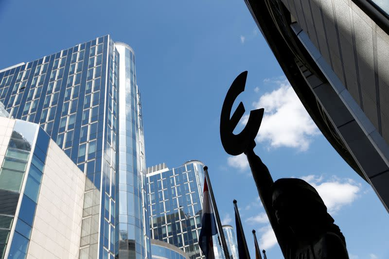 A sculpture with Euro symbol is pictured in front of the European Parliament in Brussels