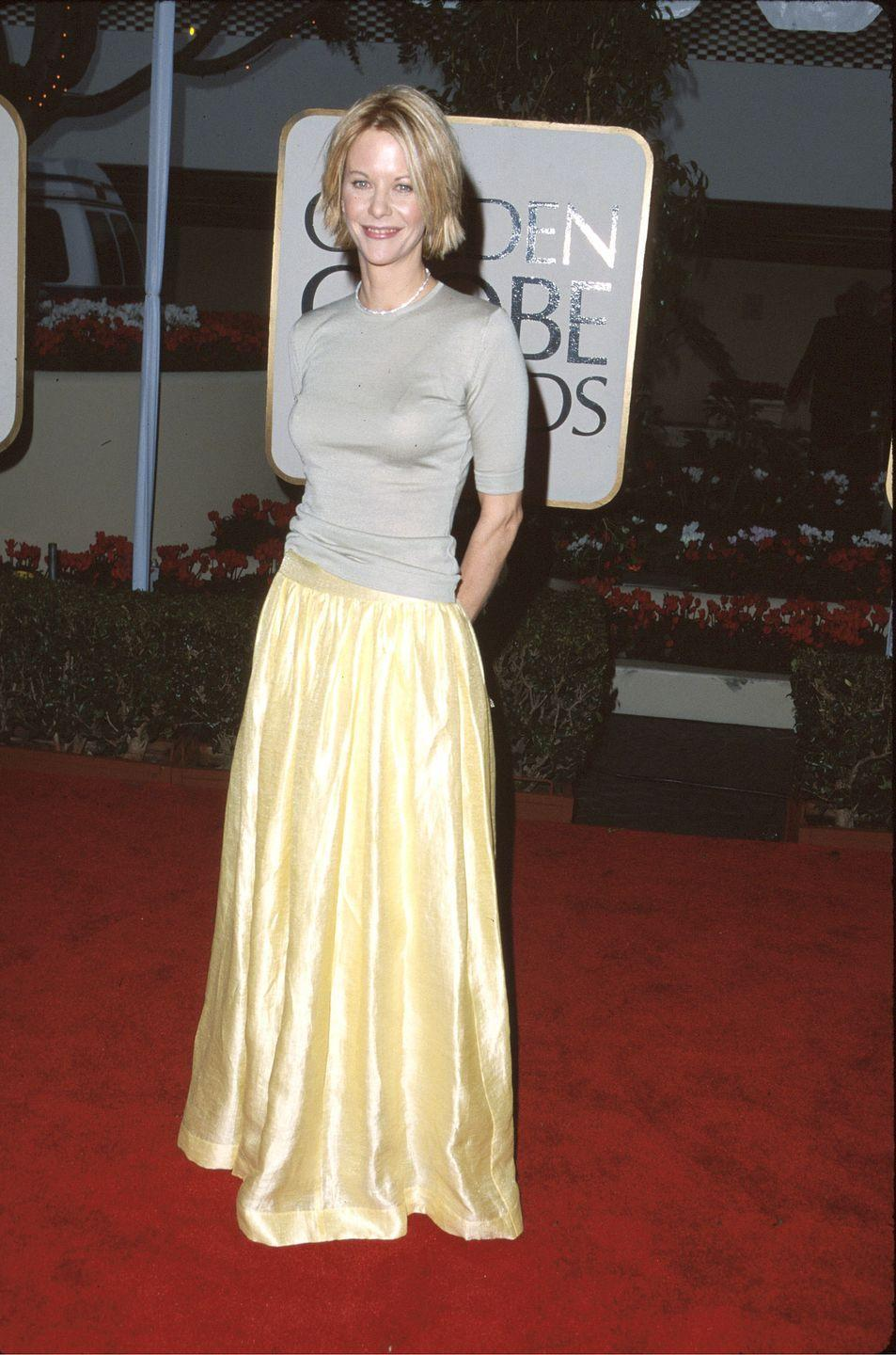<p>Another red carpet, another maxi skirt—this time worn by Meg Ryan. She paired her pastel yellow one with a short-sleeve knit for a surprisingly low-key Golden Globes 'fit. </p>