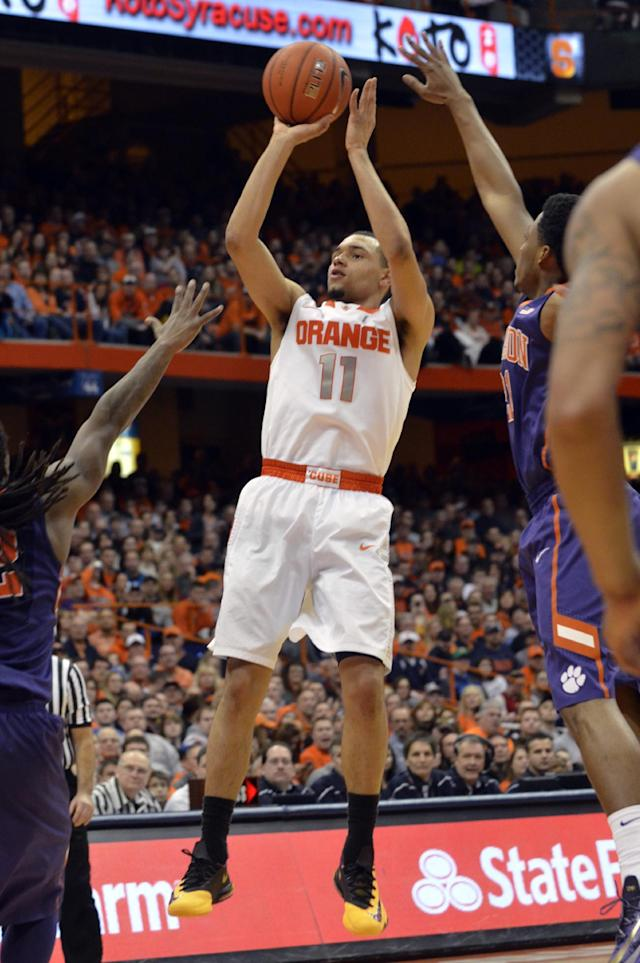 Syracuse's Tyler Ennis shoots against Clemson during the second half of an NCAA college basketball game in Syracuse, N.Y., Sunday, Feb. 9, 2014. Syracuse won 57-44. (AP Photo/Kevin Rivoli)