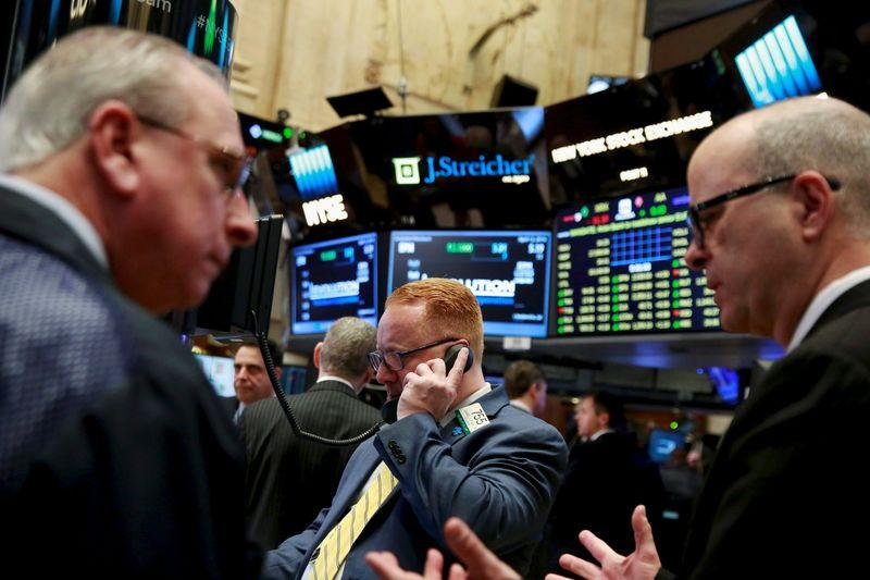 File photo of traders working on the floor of the New York Stock Exchange shortly after the opening bell in New York