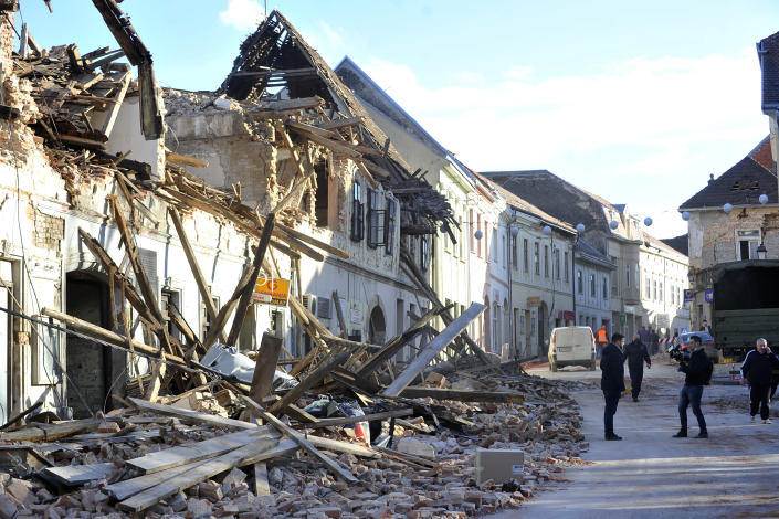 A view of remains of a building damaged in an earthquake in Petrinja, Croatia, Tuesday, Dec. 29, 2020. A strong earthquake has hit central Croatia and caused major damage and at least one death and 20 injuries in a town southeast of the capital Zagreb. (AP Photo)