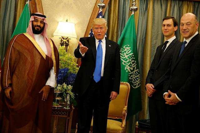 <p>President Donald Trump, flanked by White House senior advisor Jared Kushner (2nd R) and chief economic advisor Gary Cohn (R), delivers remarks to reporters after meeting with Saudi Arabia's Deputy Crown Prince and Minister of Defense Mohammed bin Salman (L) at the Ritz Carlton Hotel in Riyadh, Saudi Arabia on May 20, 2017. (Photo: Jonathan Ernst/Reuters) </p>