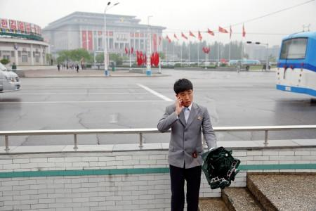 FILE PHOTO : A man speaks on the phone in front of the April 25 House of Culture, venue of the Workers' Party of Korea (WPK) congress in Pyongyang, North Korea