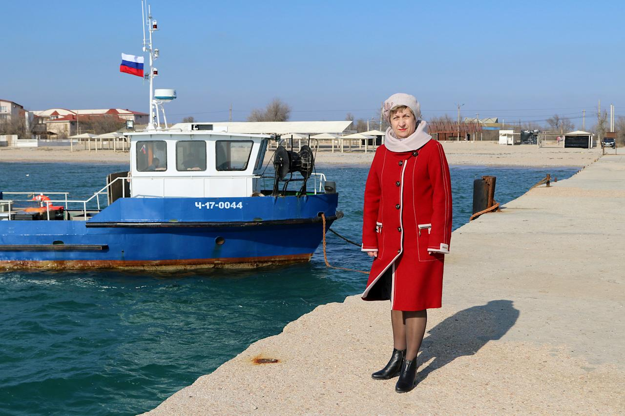 "<p>Marina Kalinichenko, 54, a math teacher and supporter of presidential candidate Vladimir Putin, poses for a picture in Yevpatoriya, Crimea, Feb. 21, 2018. ""As Mark Twain said, 'if voting made a difference, they wouldn't let us do it'. I really do support my candidate, but I also realise that it's the oligarchs that truly decide, who becomes president."" said Kalinichenko. (Photo: Pavel Rebrov/Reuters) </p>"