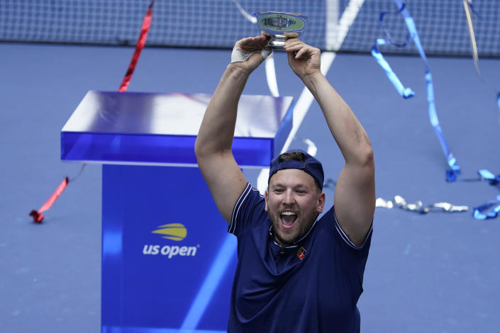 Dylan Alcott, of Australia, celebrates after defeating Niels Vink, of the Netherlands, during the men's wheelchair quad singles final at the U.S. Open tennis tournament in New York, Sunday, Sept. 12, 2021. (AP Photo/Seth Wenig)