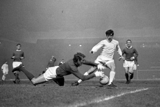 Lorimer is denied by Manchester United goalkeeper Alex Stepney