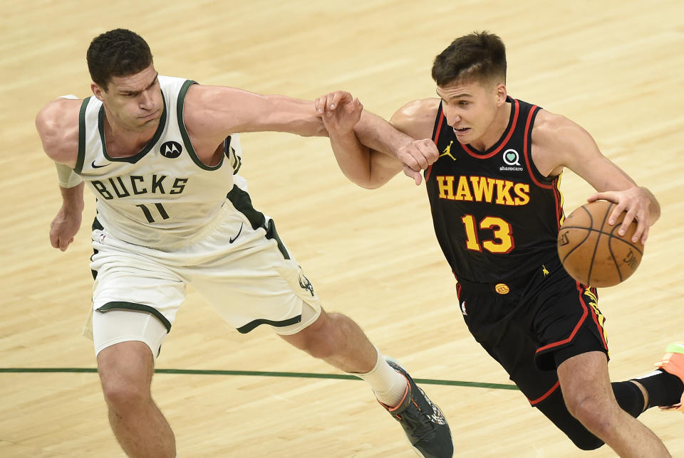 MILWAUKEE, WISCONSIN - JULY 01: Bogdan Bogdanovic #13 of the Atlanta Hawks drives to the basket against Brook Lopez #11 of the Milwaukee Bucks during the second half in Game Five of the Eastern Conference Finals at Fiserv Forum on July 01, 2021 in Milwaukee, Wisconsin. NOTE TO USER: User expressly acknowledges and agrees that, by downloading and or using this photograph, User is consenting to the terms and conditions of the Getty Images License Agreement. (Photo by Patrick McDermott/Getty Images)