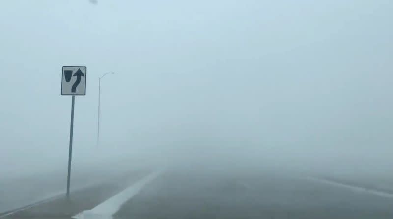 A blizzard seen along a road in Sioux Falls, South Dakota, U.S. in this still frame obtained from social media video dated December 23, 2020