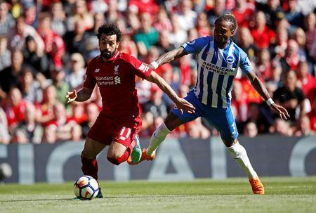 Soccer Football - Premier League - Liverpool vs Brighton & Hove Albion - Anfield, Liverpool, Britain - May 13, 2018 Liverpool's Mohamed Salah in action with Brighton's Gaetan Bong Action Images via Reuters/Carl Recine
