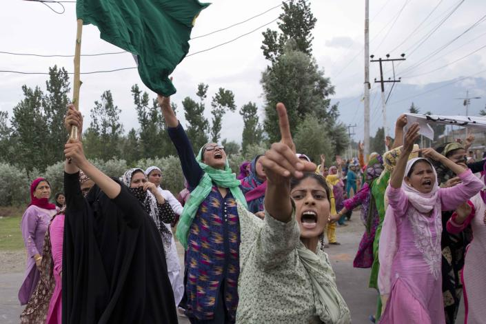 Kashmiri women shout slogans and march on a street after Friday prayers in Srinagar, Indian controlled Kashmir, Friday, Aug. 9, 2019. A strict curfew in Indian-administered Kashmir in effect for a fifth day was eased Friday to allow residents to pray at mosques, officials said, but some protests still broke out in the disputed region despite thousands of security forces in the streets as tensions remained high with neighboring Pakistan. (AP Photo/ Dar Yasin)