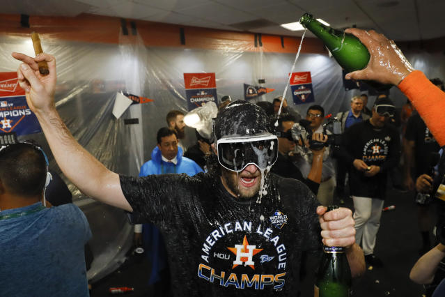Houston Astros starting pitcher Gerrit Cole celebrates in the locker room after Game 6 of baseball's American League Championship Series against the New York Yankees Sunday, Oct. 20, 2019, in Houston. The Astros won 6-4 to win the series 4-2. (AP Photo/Matt Slocum)