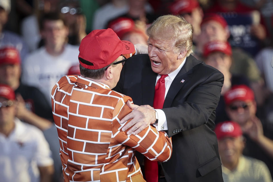 MONTOURSVILLE, PA - MAY 20: U.S. President Donald Trump calls up Blake Marnell, wearing a jacket with bricks representing a border wall, to the stage during a 'Make America Great Again' campaign rally at Williamsport Regional Airport, May 20, 2019 in Montoursville, Pennsylvania. Trump is making a trip to the swing state to drum up Republican support on the eve of a special election in Pennsylvania's 12th congressional district, with Republican Fred Keller facing off against Democrat Marc Friedenberg. (Photo by Drew Angerer/Getty Images)