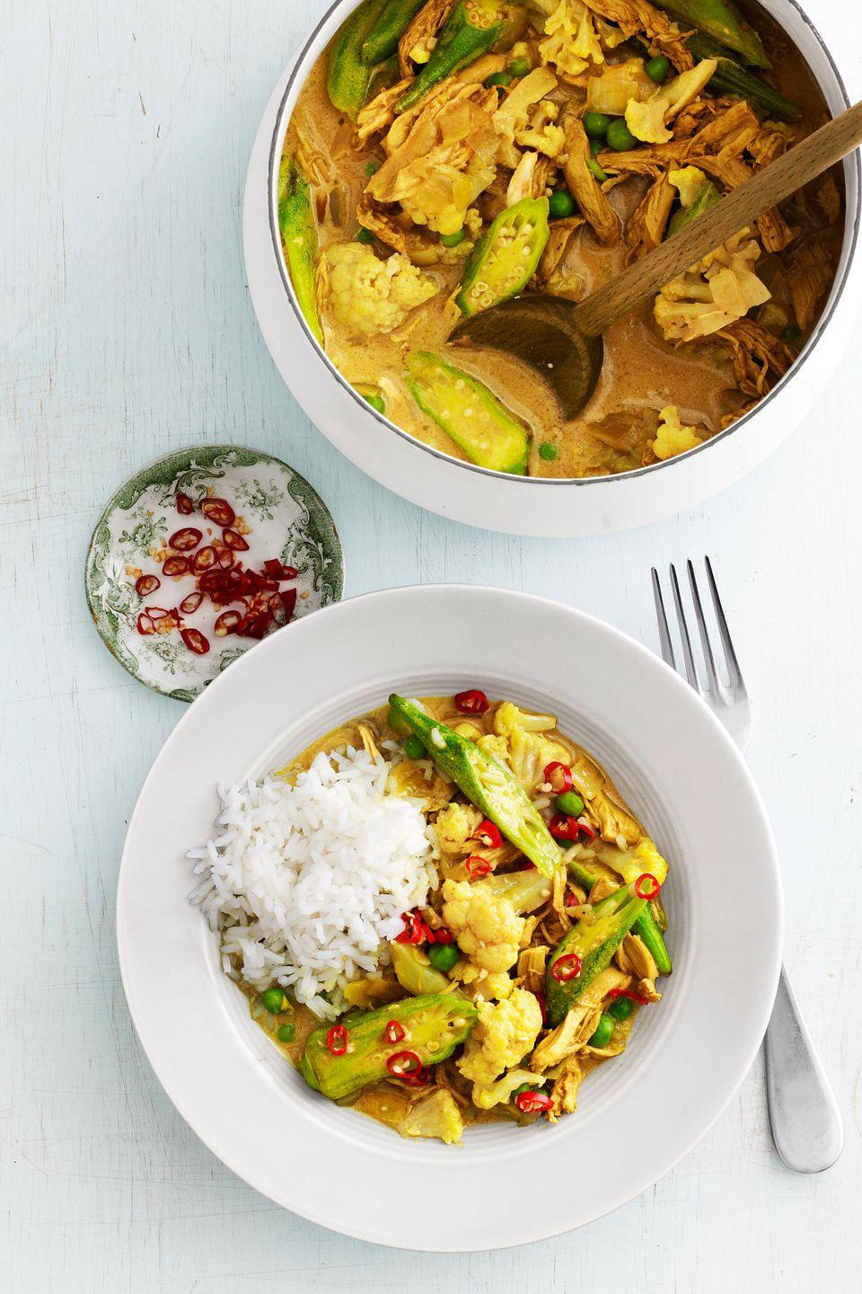 "<p>Lighten up! Substitute 2 tablespoons canola oil for the butter, and opt for light coconut milk, to save 170 calories and 20 grams of fat per serving.</p><p><strong><a href=""https://www.countryliving.com/food-drinks/recipes/a4219/chicken-okra-curry-recipe-clv0913/"" rel=""nofollow noopener"" target=""_blank"" data-ylk=""slk:Get the recipe."" class=""link rapid-noclick-resp"">Get the recipe.</a></strong></p>"