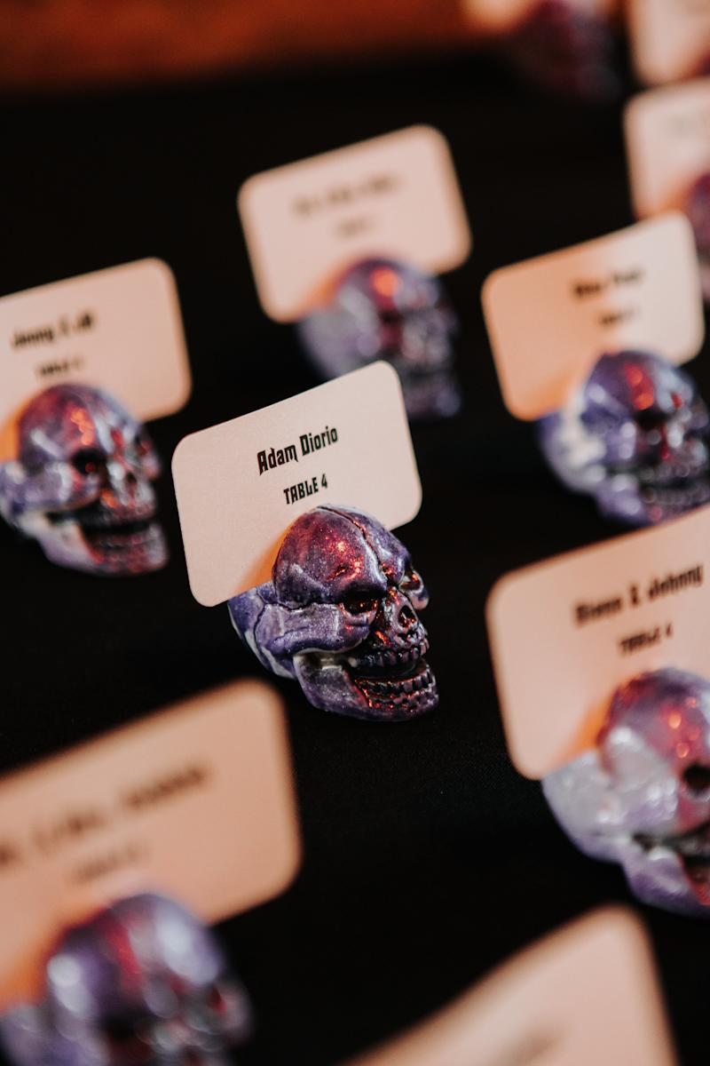 They opted for skull place cards for the October wedding, but the bride said she likes to keep those Halloween vibes going all year long. (The Ramsdens)