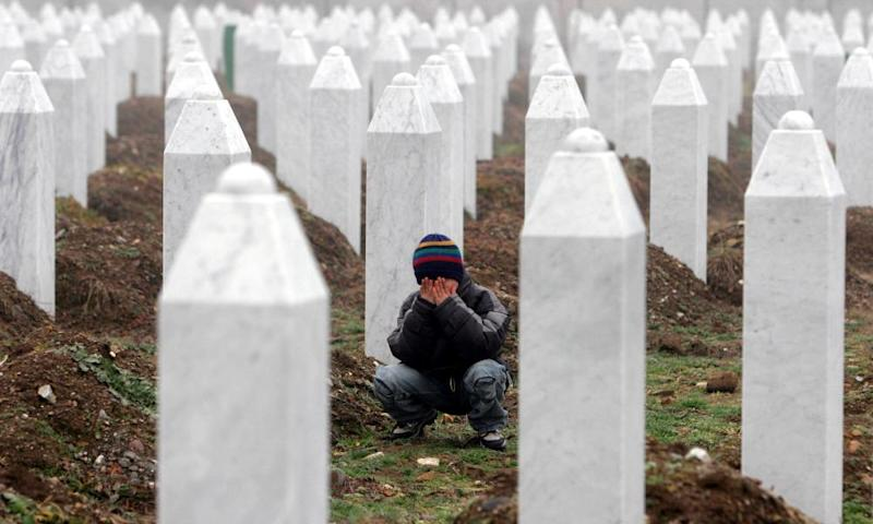 A boy weeps among the headstones of the victims of the Srebrenica massacre.