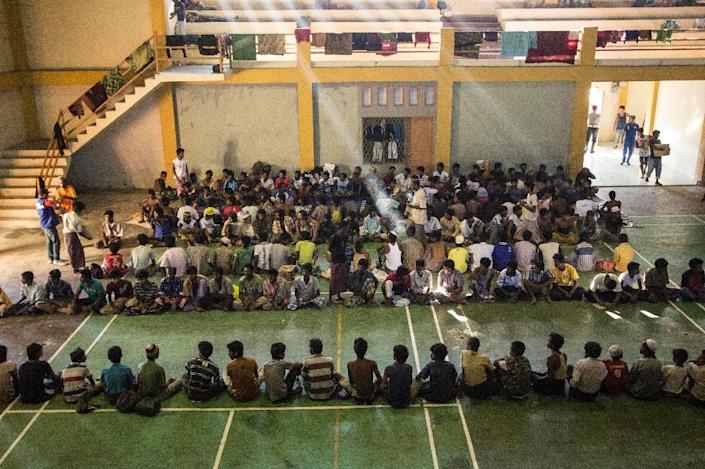 A group of migrants from Myanmar and Bangladesh, rescued from a boat on May 10, 2015, are temporarily housed at a government sports auditorium in Lhoksukon in Aceh province (AFP Photo/Reza Juanda)