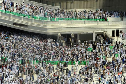 Muslim pilgrims leave after performing Friday prayer at Mecca's Grand Mosque, on October 11, 2013 as hundreds of thousands of into the holy city for the annual hajj pilgrimage