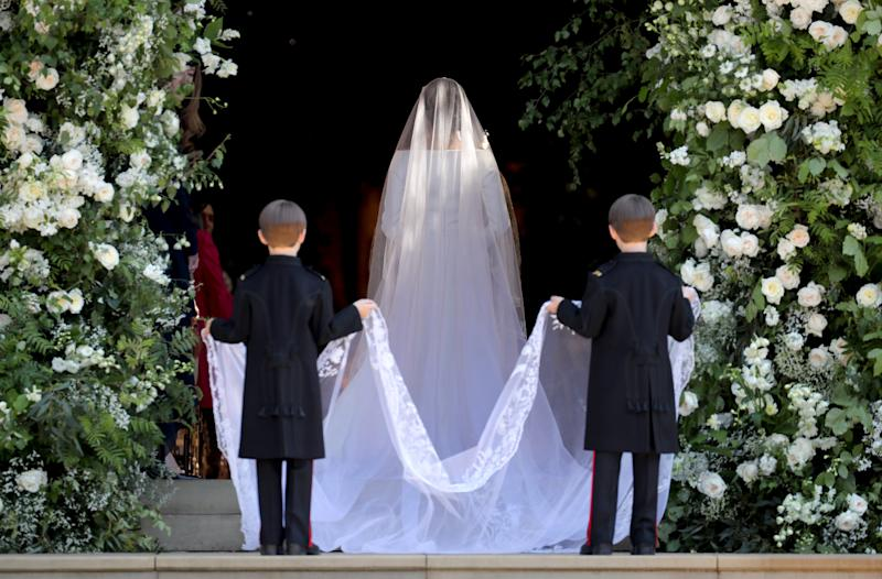 Brian and John Muloroney holding Markle's veil.  (WPA Pool via Getty Images)
