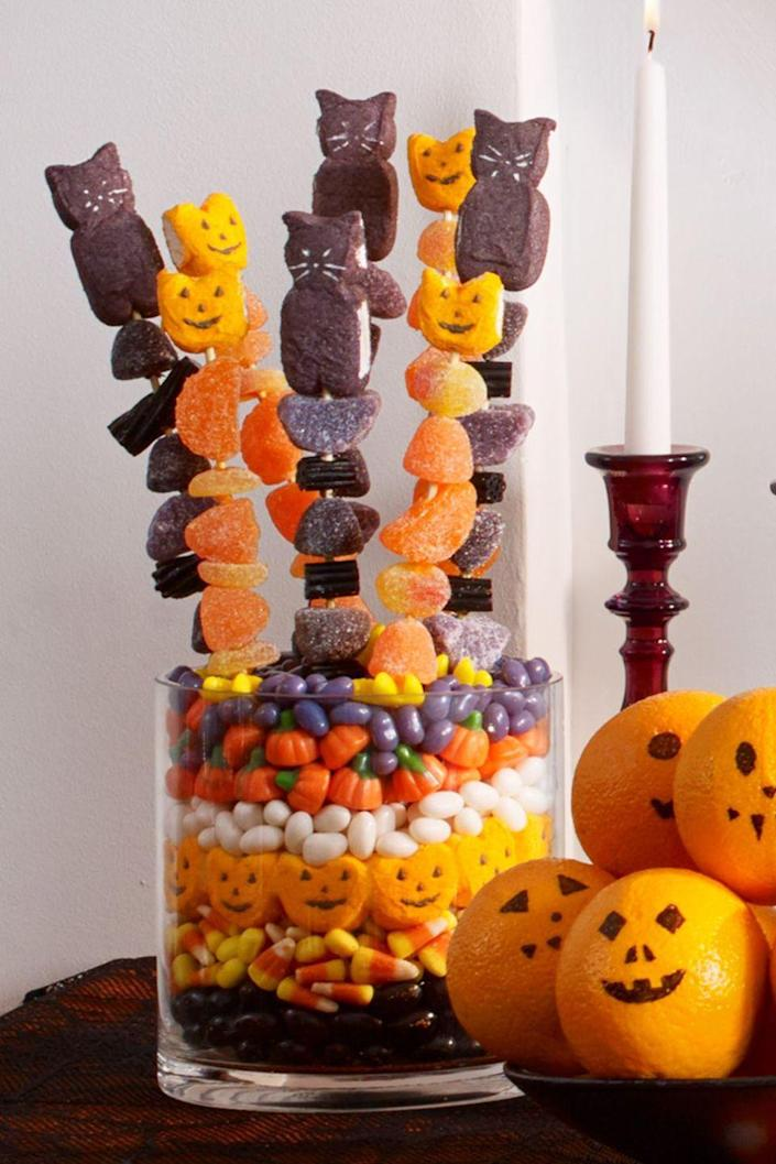 <p>Grab a few wooden skewers and stack colorful gummies and marshmallow treats onto them for a grab-and-go dessert the kids will go nuts over. </p>