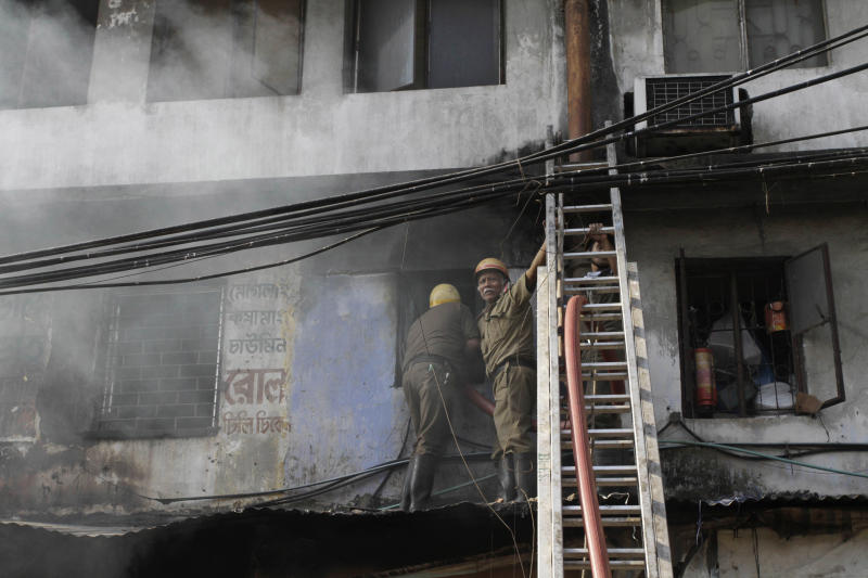 Indian firemen try to douse a fire that broke out early morning at an illegal six-story plastics market in Kolkata, India, Wednesday, Feb. 27, 2013. More than a dozen people were killed and others were hospitalized in critical condition. (AP Photo/Bikas Das)