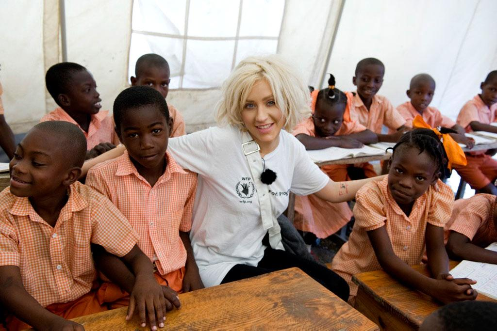 """Christina Aguilera visited two schools in the quake-stricken nation of Haiti Tuesday as the World Food Program's new Ambassador Against Hunger. Aguilera told E! Online, """"I was so moved by the devastation in Haiti but also by the spirit of its people. The children have such joy and are eager to learn despite the destruction around them. The children deserve a chance, and I want to make sure they get a chance."""" WFP/Rein Skullerud"""