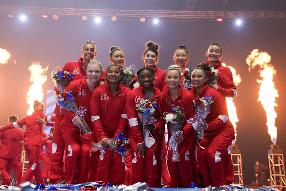 Members of the women's Olympic gymnastics team and alternates pose during the U.S. Olympic Team Trials.