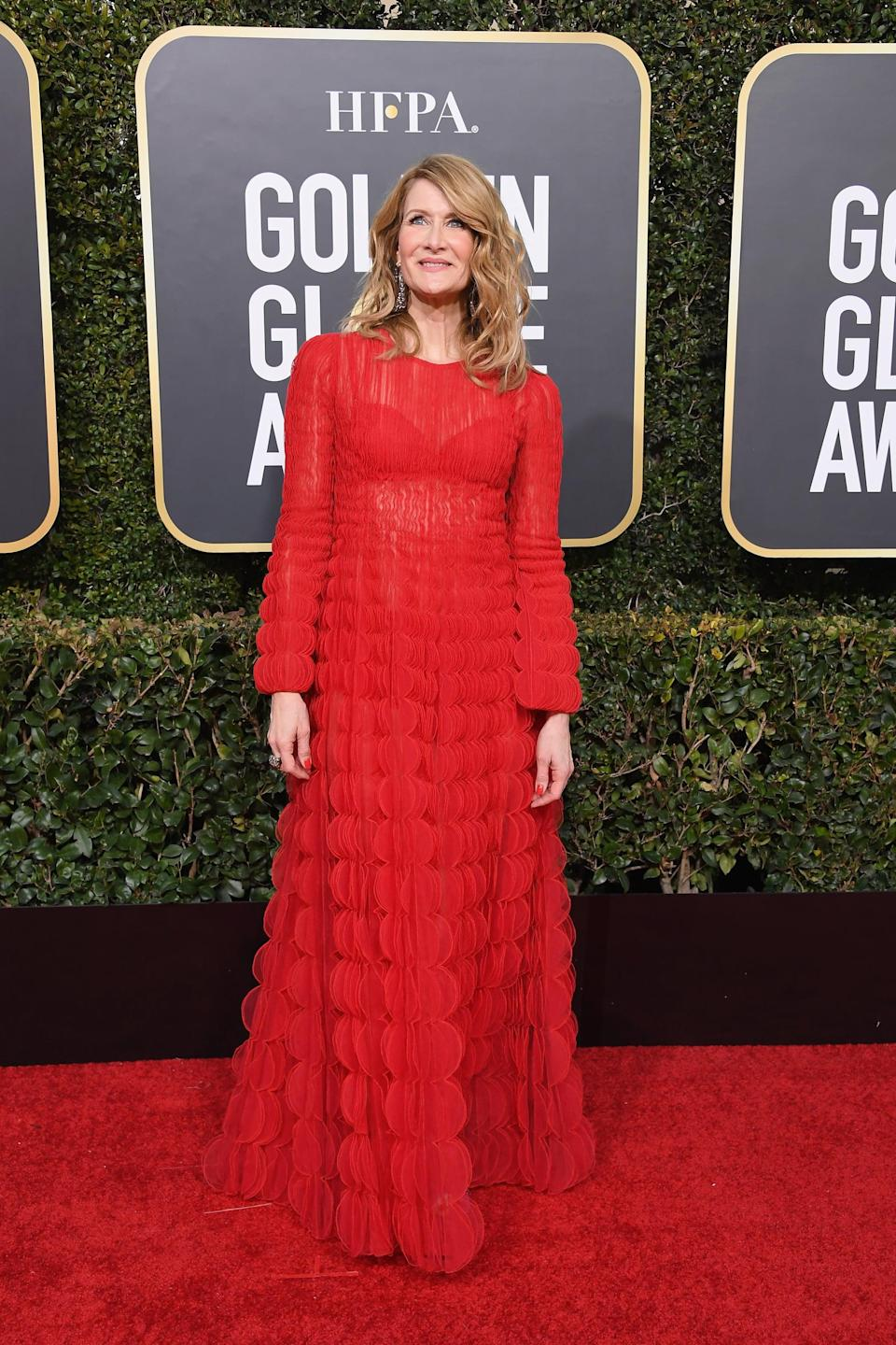 <p>Wearing a Valentino dress with Lorraine Schwartz jewels and a Time's Up ribbon on her purse.</p>