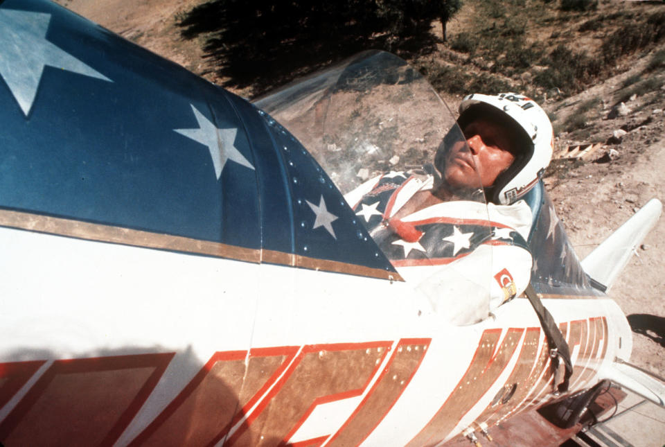 """FILE - In this Sept. 8, 1974, file photo, Evel Knievel sits in the steam powered rocket motorcycle that will hopefully take him across Snake River Canyon in Twin Falls, Idaho. A judge has dismissed a trademark infringement lawsuit filed by Evel Knievel's son against the Walt Disney Co. and movie company Pixar over a """"Toy Story 4"""" daredevil character named Duke Caboom. Kelly Knievel said Monday, Sept. 27, 2021, he's disappointed and may take the case to the 9th Circuit Court of Appeals in San Francisco. (AP Photo, File)"""