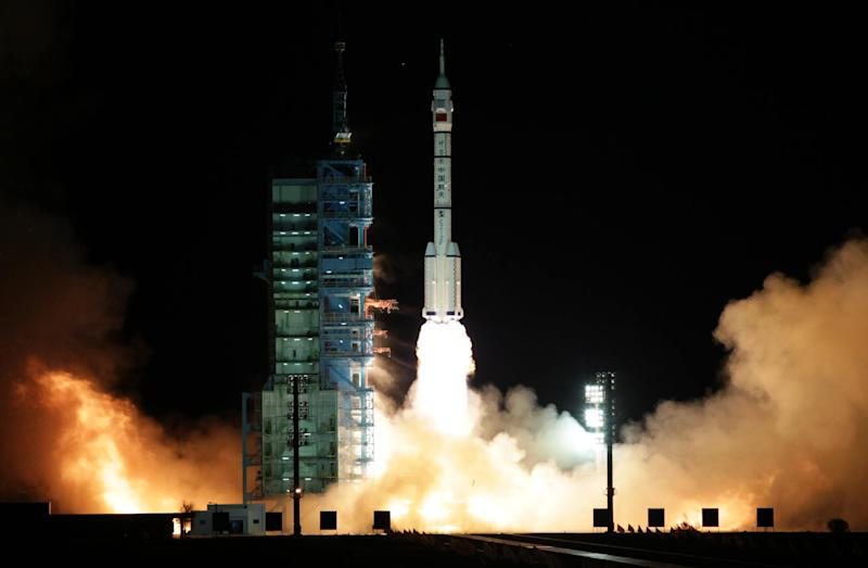In this photo released by China's Xinhua News Agency, a modified model of the Long March CZ-2F rocket carrying the unmanned spacecraft Shenzhou-8 blasts off from the launch pad at the Jiuquan Satellite Launch Center in northwest China's Gansu Province, Tuesday, Nov. 1, 2011.  China's unmanned spacecraft Shenzhou 8 blasted off Tuesday morning, the Chinese state media reported. It is the latest step in what will be a decade-long effort by China to place a manned permanent space station in orbit. (AP Photo/Xinhua, Li Gang) NO SALES