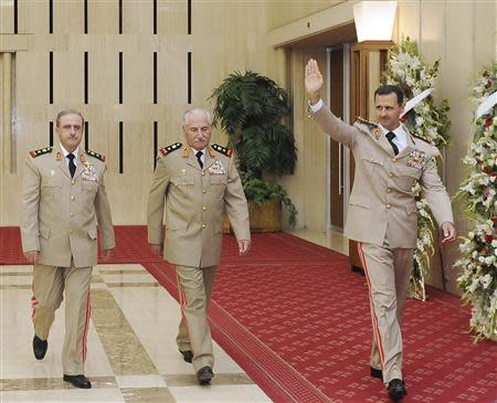 Syria's President Bashar al-Assad (R) waves as he arrives with Syrian Defense Minister General Ali Habib (C) and Chief of Staff General Dawoud Rajha to attend a dinner to honour army officers on the 65th Army Foundation anniversary in Damascus in this August 1, 2010 file photo. Former Syrian Defence Minister General Ali Habib, a prominent member of President Bashar al-Assad's Alawite sect, has defected and is now in Turkey, a senior member of the opposition Syrian National Coalition told Reuters on September 4, 2013. REUTERS/SANA/Handout