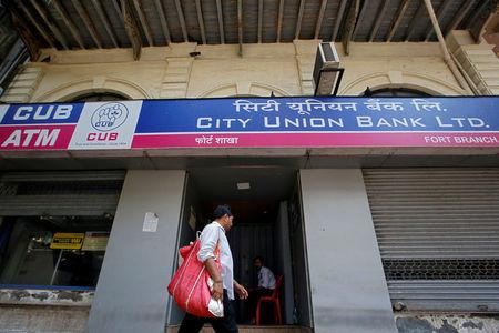 A man walks past a City Union Bank branch in Mumbai