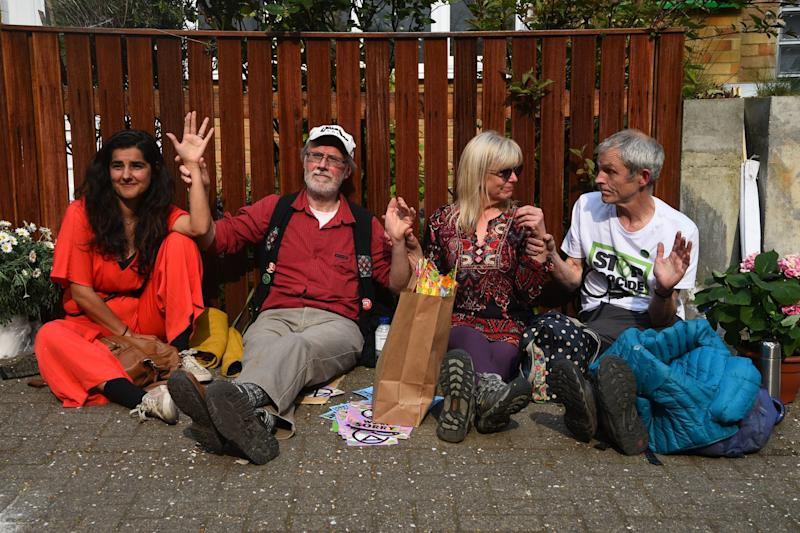 Climate activists who have glued themselves together sit outside Labour Party leader Jeremy Corbyn's house (PA)