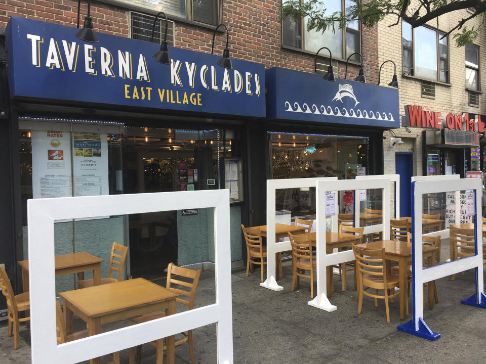 DECEMBER 14th 2020: The ban on indoor dining at restaurants in New York City was reinstated effective Monday, December 14, 2020 for at least two weeks due to recent surges in cases of the COVID-19 coronavirus. Restaurant owners and managers face formidable challenges in the months ahead as the colder weather of the approaching winter will limit outdoor dining. - File Photo by: zz/STRF/STAR MAX/IPx 2020 6/26/20 Social distancing measures on June 26, 2020 as restaurants begin to reopen as certain restrictions are eased in New York City during the worldwide coronavirus pandemic. Here, sidewalk seating for outdoor dining with partitions at Taverna Kyclades Greek Restaurant, East Village, Downtown Manhattan, New York City. (NYC)
